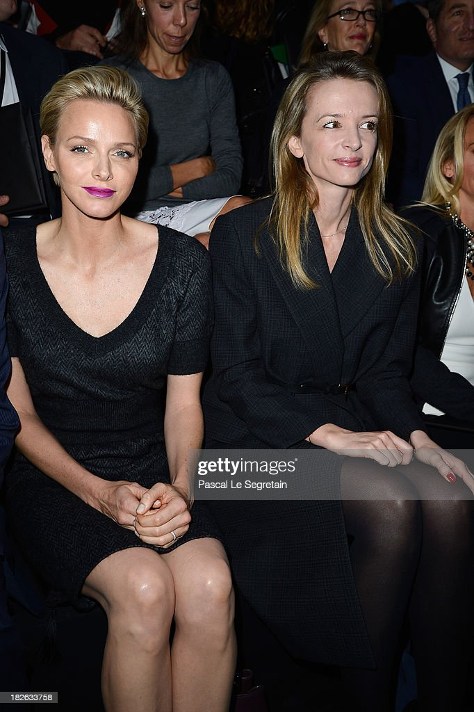 Princess Charlene of Monaco and Delphine Arnault attend the Louis Vuitton show as part of the Paris Fashion Week Womenswear Spring/Summer 2014 at Le Carre du Louvre on October 2, 2013 in Paris, France.