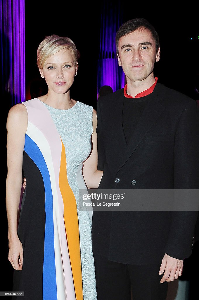 Princess Charlene of Monaco and fashion designer Raf Simons attend the Dior Cruise Collection 2014 cocktail on May 18, 2013 in Monaco, Monaco.