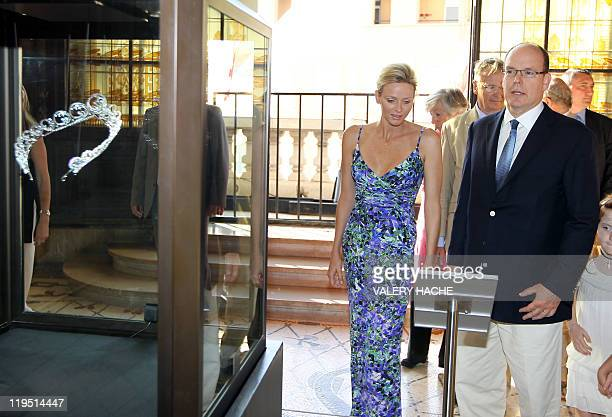 Princess Charlene of Monaco and her husband Prince Albert II of Monaco look at her diadem during their visit of the exhibition entitled L'Histoire du...