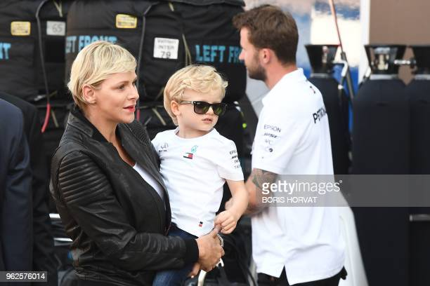 Princess Charlene of Monaco and her son Prince Jacques of Monaco visit the Mercedes AMG Petronas F1 team pit on May 25 ahead of the Monaco Formula...