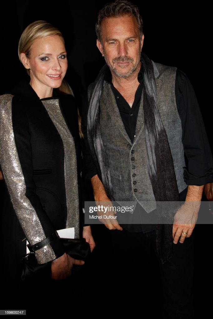Princess Charlene of Monaco and Kevin Costner attend the Versace Spring/Summer 2013 Haute-Couture show as part of Paris Fashion Week at Le Centorial on January 20, 2013 in Paris, France.