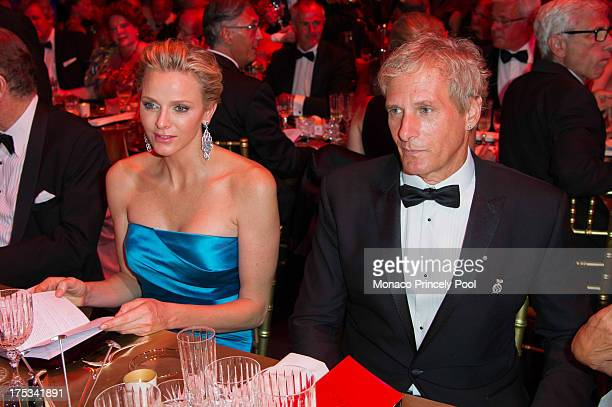 Princess Charlene of Monaco and Michael Bolton attend the 65th Monaco Red Cross Ball Gala at Sporting MonteCarlo on August 2 2013 in MonteCarlo Monaco