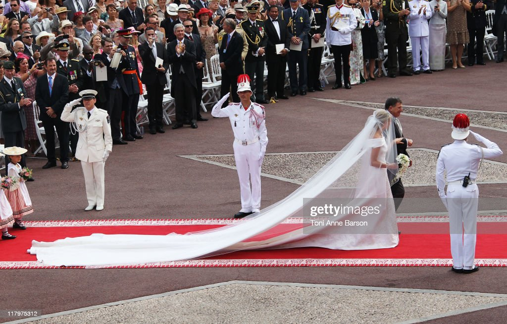 Princess Charlene of Monaco and Michael Kenneth Wittstock arrive at the religious ceremony of the Royal Wedding of Prince Albert II of Monaco to Princess Charlene of Monaco at the Prince's Palace of Monaco on July 2, 2011 in Monaco.