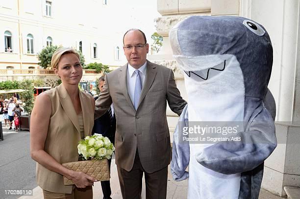 Princess Charlene of Monaco and Prince Albert II of Monaco arrive at Oceanographic Museum on June 10 2013 in MonteCarlo Monaco