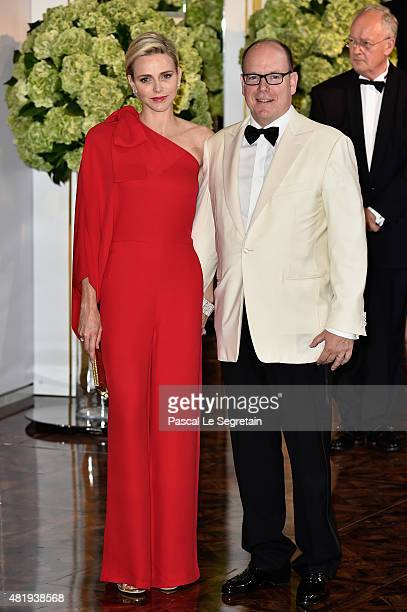 Princess Charlene of Monaco and Prince Albert II of Monaco arrive at the Monaco Red Cross Gala on July 25 2015 in MonteCarlo Monaco