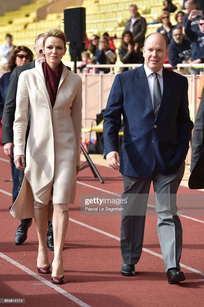 Princess Charlene of Monaco and Prince Albert II of Monaco arrive at the Sainte Devote Rugby Tournament on March 18, 2017 in Monte-Carlo, Monaco.