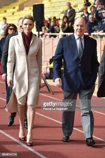 Princess Charlene of Monaco and Prince Albert II of Monaco arrive at the Sainte Devote Rugby Tournament on March 18 2017 in MonteCarlo Monaco