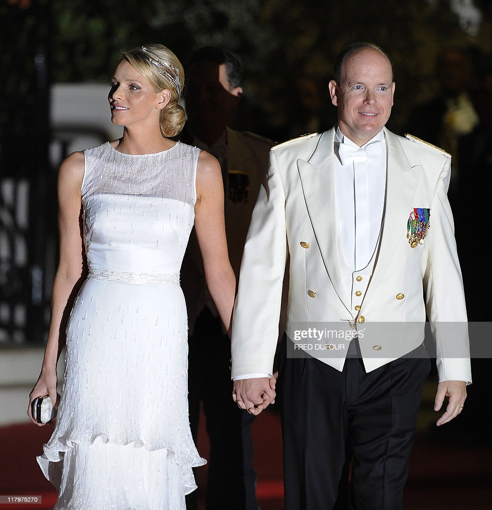 Princess Charlene of Monaco and Prince Albert II of Monaco arrive for a dinner at Opera terraces after their religious wedding ceremony on July 2, 2011 in Monaco.
