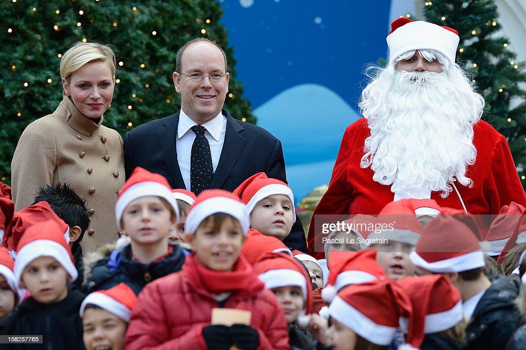 Princess Charlene of Monaco and Prince Albert II of Monaco attend the Christmas Celebration For Monaco Children on December 12, 2012 in Monaco, Monaco.