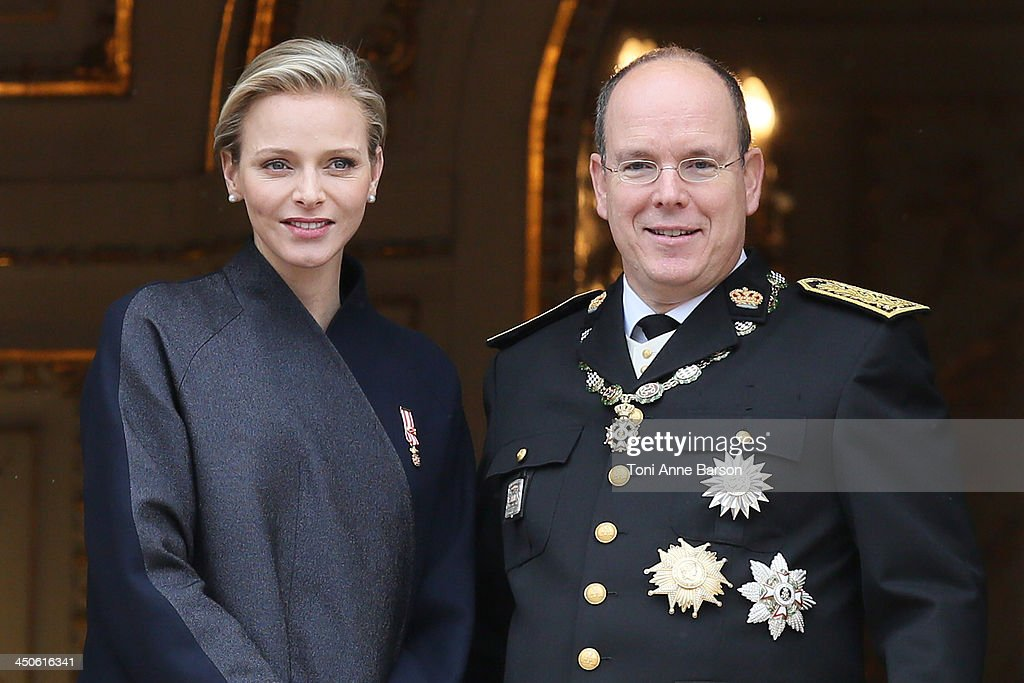 Princess Charlene of Monaco and Prince Albert II of Monaco attend the National Day Parade as part of Monaco National Day Celebrations at Monaco Palace on November 19, 2013 in Monte-Carlo, Monaco.