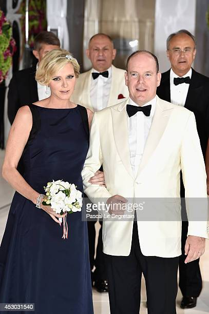 Princess Charlene of Monaco and Prince Albert II of Monaco attend the 66th Monaco Red Cross Ball Gala at Sporting MonteCarlo on August 1 2014 in...