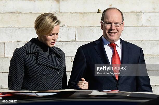 Princess Charlene of Monaco and Prince Albert II of Monaco attend the SainteDevote ceremony on January 26 2014 in Monaco Monaco