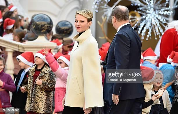 Princess Charlene of Monaco and Prince Albert II of Monaco attend the Christmas gifts distribution on December 16 2015 in Monaco Monaco
