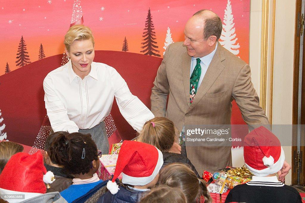 Princess Charlene of Monaco and Prince Albert II of Monaco attend the Christmas gifts distribution at Monaco Palace on December 14, 2016 in Monaco, Monaco.
