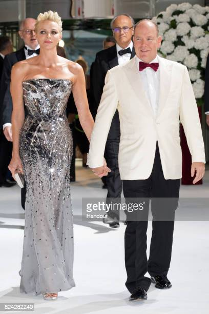Princess Charlene of Monaco and Prince Albert II of Monaco attend the 69th Monaco Red Cross Ball Gala at Sporting Monte-Carlo on July 28, 2017 in...
