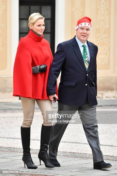 Princess Charlene of Monaco and Prince Albert II of Monaco attend the Christmas Gifts Distribution on December 20 2017 in Monaco Monaco