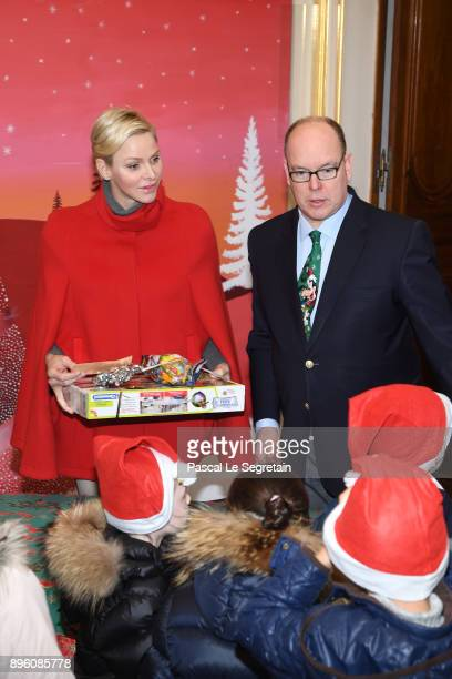 Princess Charlene of Monaco and Prince Albert II of Monaco attend the Christmas Gifts Distribution on December 20 2017 in Monaco Monaco