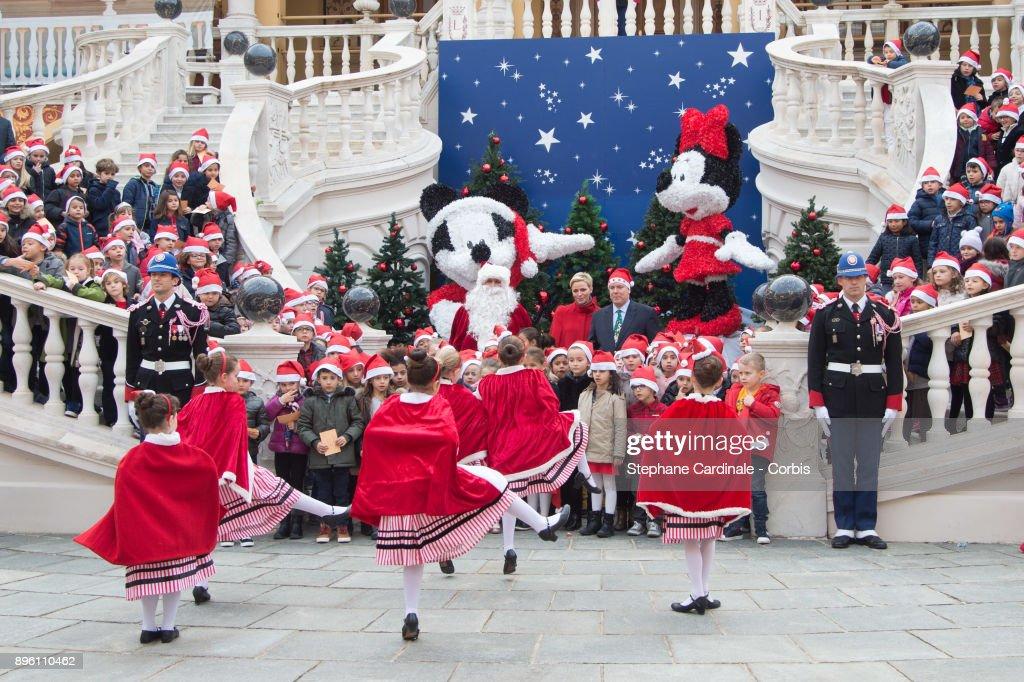 Princess Charlene of Monaco and Prince Albert II of Monaco attend the Christmas Gifts Distribution on December 20, 2017 in Monaco, Monaco.