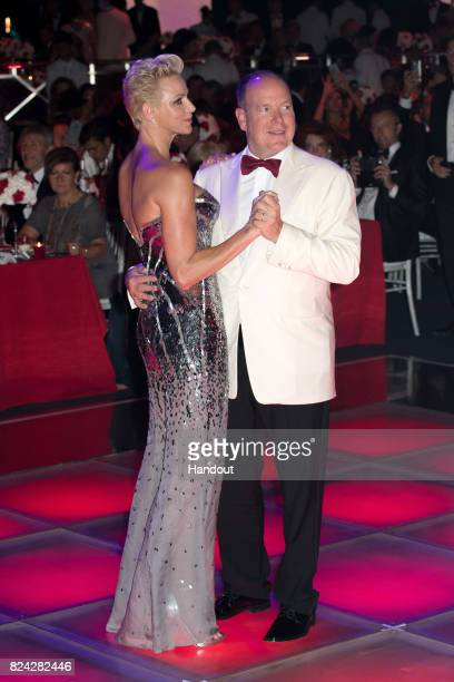 Princess Charlene of Monaco and Prince Albert II of Monaco dance at the 69th Monaco Red Cross Ball Gala at Sporting MonteCarlo on July 28 2017 in...
