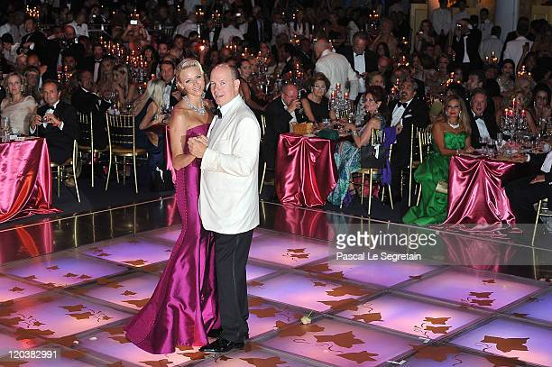 Princess Charlene of Monaco and Prince Albert II of Monaco dance during the 63rd Red Cross Ball at the Sporting MonteCarlo on August 5 2011 in...