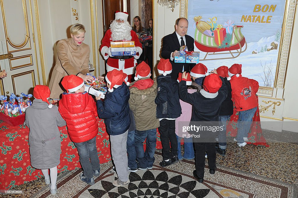 Princess Charlene of Monaco and Prince Albert II of Monaco distribute presents to Monegasque children during the Christmas Celebration For Monaco Children on December 12, 2012 in Monaco, Monaco.