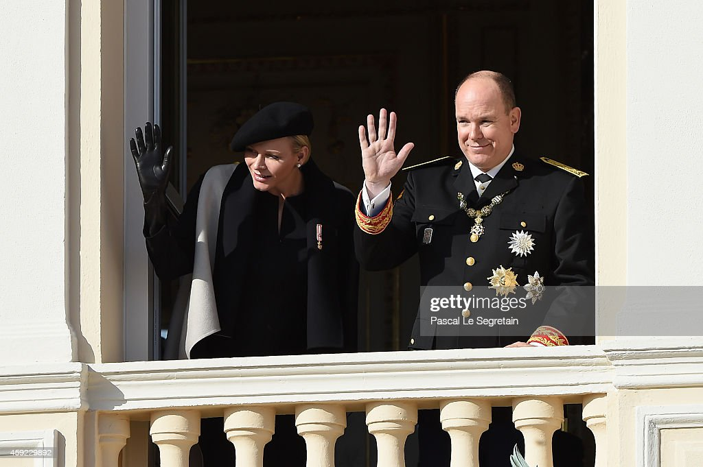 Princess Charlene of Monaco and Prince Albert II of Monaco greet the crowd from the palace's balcony during the National Day Parade as part of Monaco National Day Celebrations on November 19, 2014 in Monaco, Monaco.