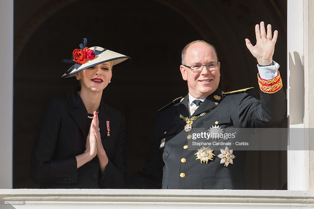 Princess Charlene of Monaco and Prince Albert II of Monaco greet the crowd from the palace's balcony during the Monaco National Day Celebrations on November 19, 2016 in Monaco, Monaco.