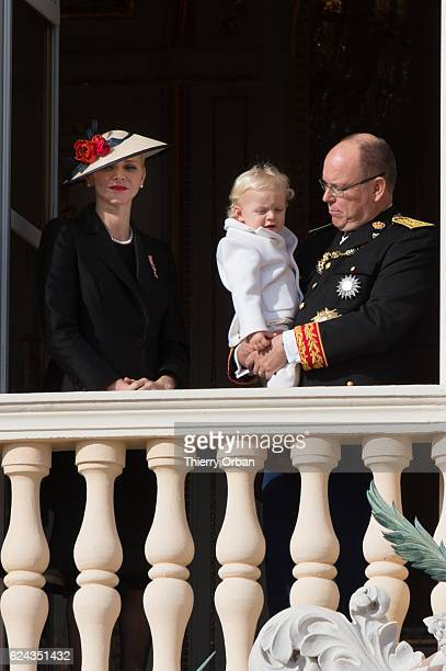 Princess Charlene of Monaco and Prince Albert II of Monaco greet the crowd from the palace's balcony with Prince Jacques of Monaco during the Monaco...