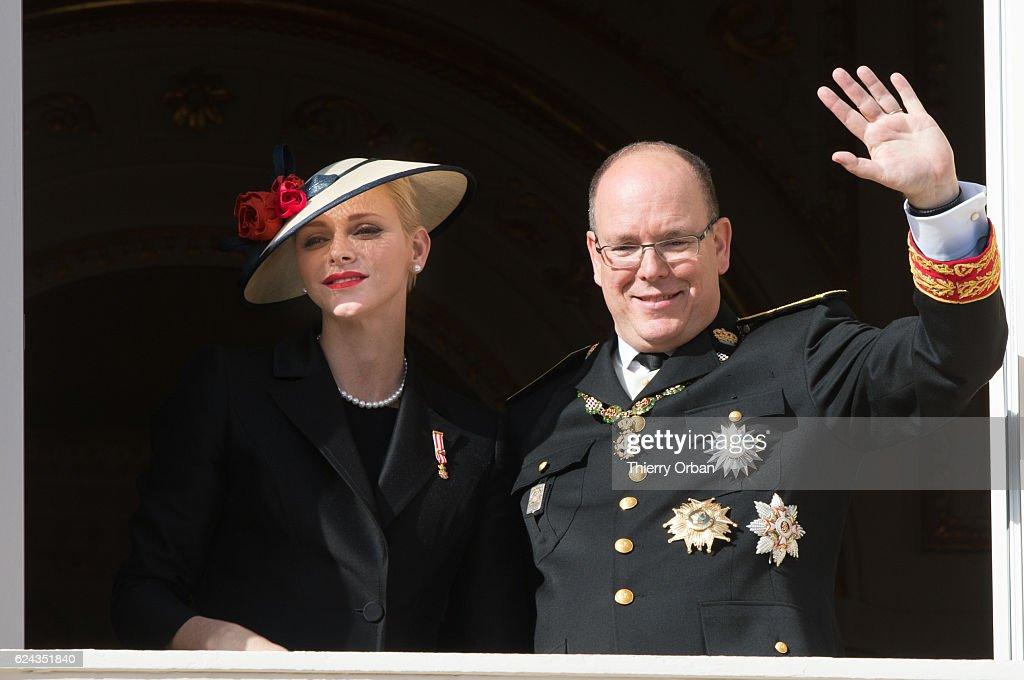 Princess Charlene of Monaco and Prince Albert II of Monaco greet the crowd from the palace's balcony during the Monaco National Day Celebrations on November 19, 2016 in Monaco, Monaco.