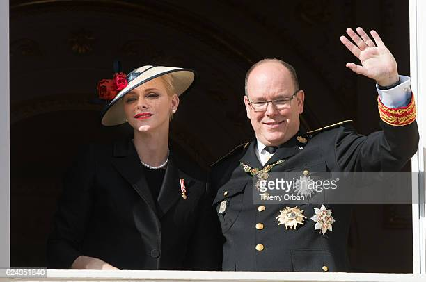 Princess Charlene of Monaco and Prince Albert II of Monaco greet the crowd from the palace's balcony during the Monaco National Day Celebrations on...