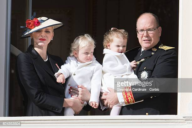 Princess Charlene of Monaco and Prince Albert II of Monaco greet the crowd from the palace's balcony with their children Prince Jacques of Monaco and...