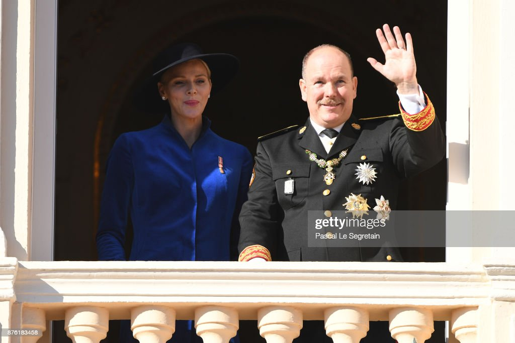 Princess Charlene of Monaco and Prince Albert II of Monaco greet the crowd from the palace's balcony during the Monaco National Day Celebrations on November 19, 2017 in Monaco, Monaco.
