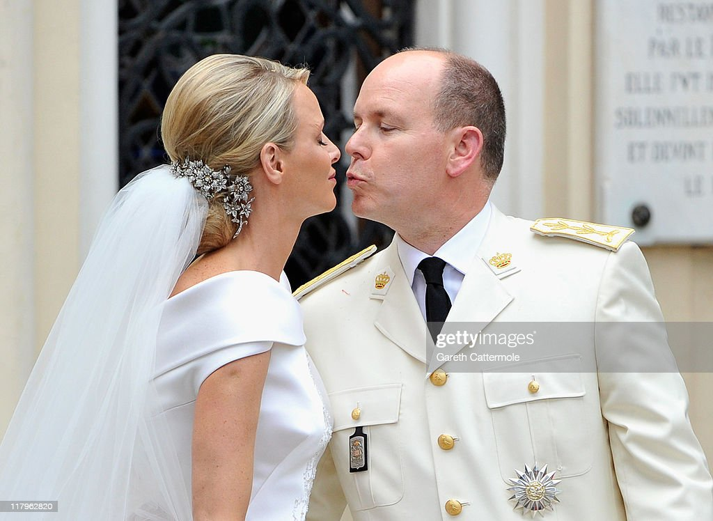 Princess Charlene of Monaco and Prince Albert II of Monaco kiss as they leave Sainte Devote church after their religious wedding ceremony at the Prince's Palace of Monaco on July 2, 2011 in Monaco. The Roman-Catholic ceremony followed the civil wedding which was held in the Throne Room of the Prince's Palace of Monaco on July 1. With her marriage to the head of state of the Principality of Monaco, Charlene Wittstock has become Princess consort of Monaco and gains the title, Princess Charlene of Monaco. Celebrations including concerts and firework displays are being held across several days, attended by a guest list of global celebrities and heads of state.