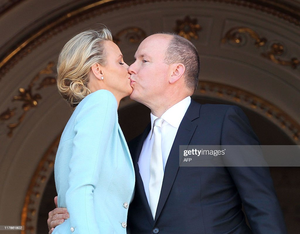 Princess Charlene of Monaco and Prince Albert II of Monaco kiss on the balcony after the civil ceremony of the Royal Wedding of Prince Albert II of Monaco to Charlene Wittstock at the Prince's Palace on July 1, 2011 in Monaco. The ceremony will take/took place in the Throne Room of the Prince's Palace of Monaco, followed by a religious ceremony to be conducted in the main courtyard of the Palace on July 2. With her marriage to the head of state of Principality of Monaco, Charlene Wittstock has/will become Princess consort of Monaco and gain the title, Princess Charlene of Monaco. Celebrations including concerts and firework displays are being held across several days, attended by a guest list of global celebrities and heads of state.