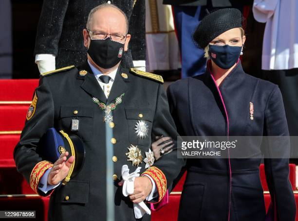 Princess Charlene of Monaco and Prince Albert II of Monaco leave after attending a mass during the celebrations marking Monaco's National Day at the...