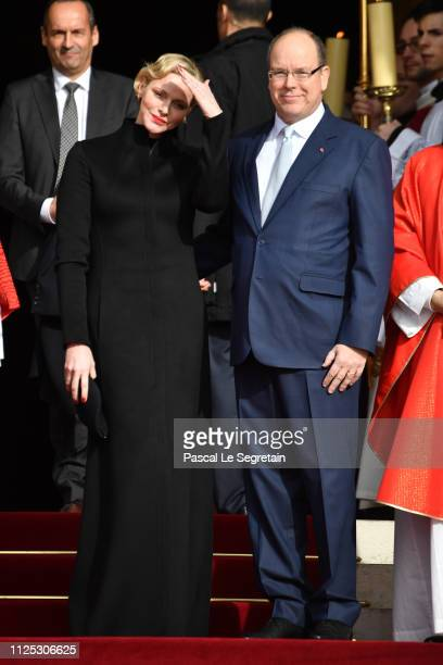 Princess Charlene of Monaco and Prince Albert II of Monaco leave the Monaco Cathedral during the Celebration Of The SainteDevote In Monaco on January...