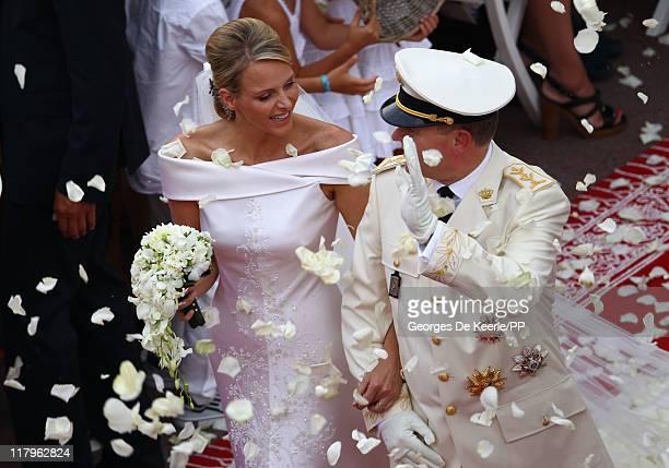 Princess Charlene of Monaco and Prince Albert II of Monaco leave the religious ceremony of the Royal Wedding of Prince Albert II of Monaco to...