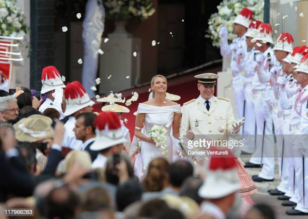 Princess Charlene of Monaco and Prince Albert II of Monaco leave the religious ceremony of the Royal Wedding of Prince Albert II of Monaco to...