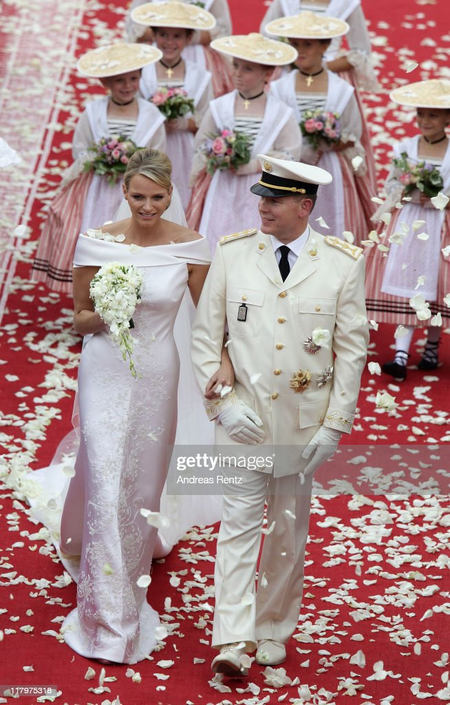 Princess Charlene of Monaco and Prince Albert II of Monaco leave the religious ceremony of the Royal Wedding of Prince Albert II of Monaco to Princess Charlene of Monaco in the main courtyard at the Prince's Palace on July 2, 2011 in Monaco. The Roman-Catholic ceremony follows the civil wedding which was held in the Throne Room of the Prince's Palace of Monaco on July 1. With her marriage to the head of state of the Principality of Monaco, Charlene Wittstock has become Princess consort of Monaco and gains the title, Princess Charlene of Monaco. Celebrations including concerts and firework displays are being held across several days, attended by a guest list of global celebrities and heads of state.