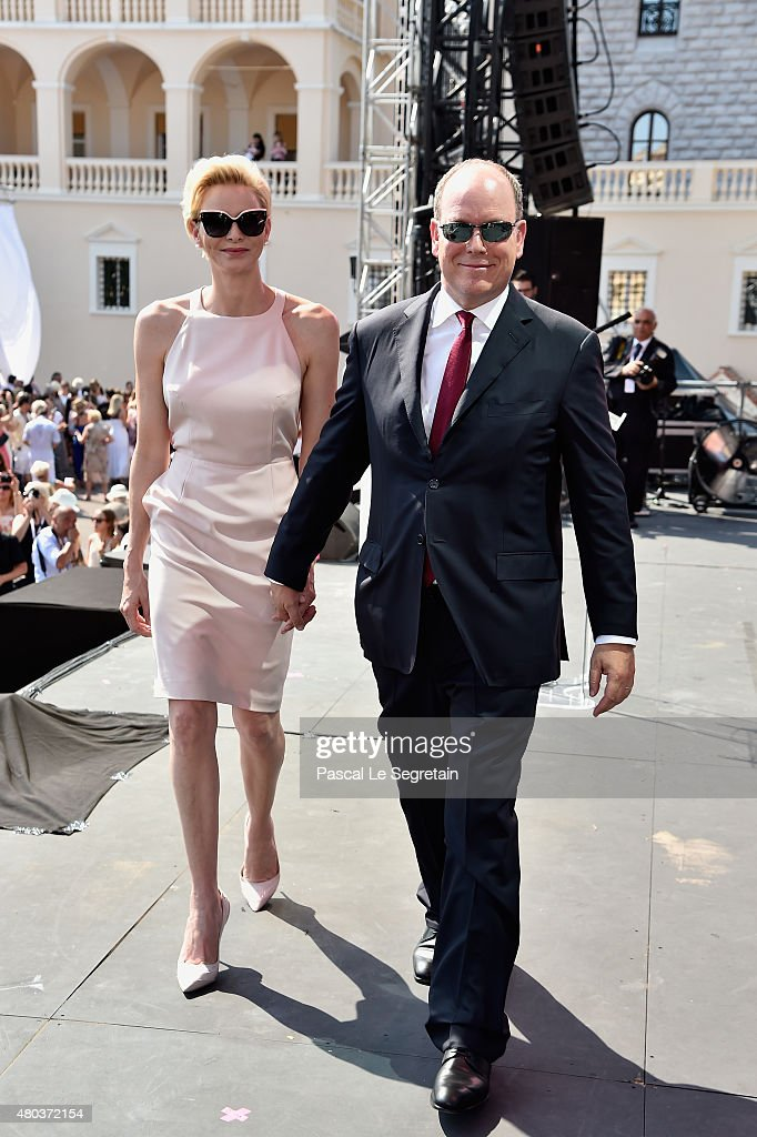 Princess Charlene of Monaco and Prince Albert II of Monaco leave the stage during the First Day of the 10th Anniversary on the Throne Celebrations on July 11, 2015 in Monaco, Monaco.