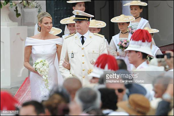 Princess Charlene of Monaco and Prince Albert II of Monaco leave the religious ceremony of the Wedding at the Prince's Palace in Monaco