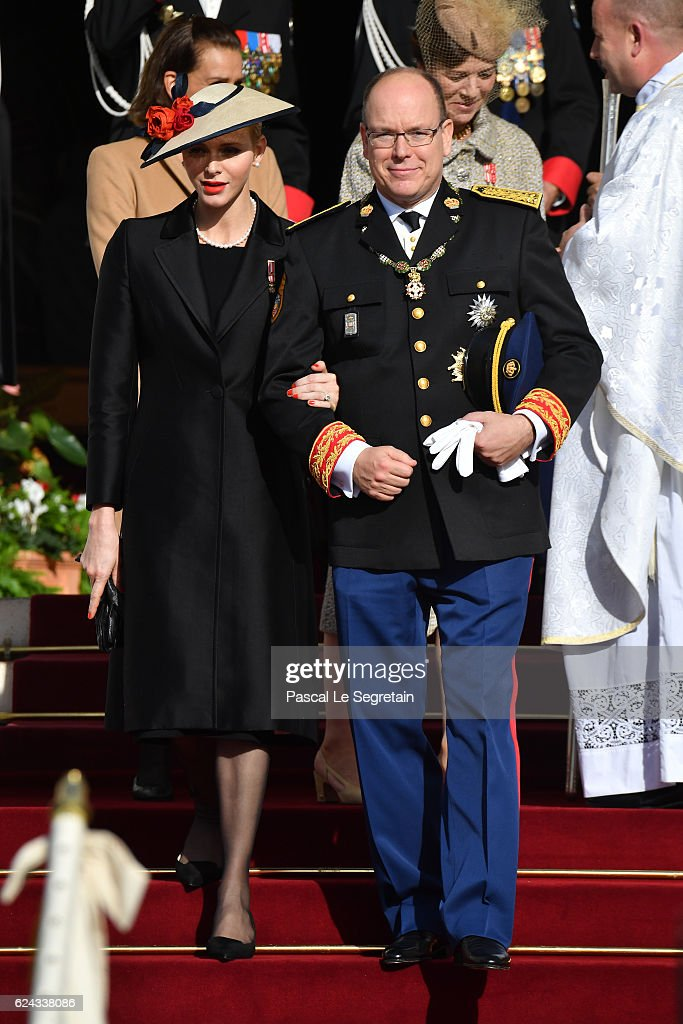 Princess Charlene of Monaco and Prince Albert II of Monaco leave the Cathedral of Monaco after a mass during the Monaco National Day Celebrations on November 19, 2016 in Monaco, Monaco.