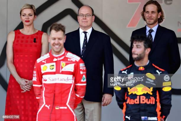 Princess Charlene of Monaco and Prince Albert II of Monaco look on during the podium ceremony with race winner Sebastian Vettel of Germany and...