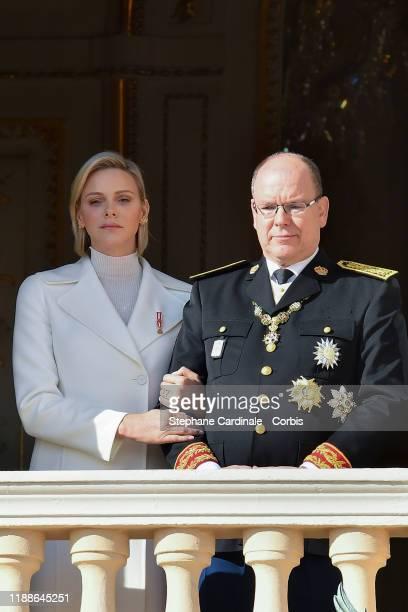 Princess Charlene of Monaco and Prince Albert II of Monaco pose at the Palace balcony during the Monaco National Day Celebrations on November 19,...
