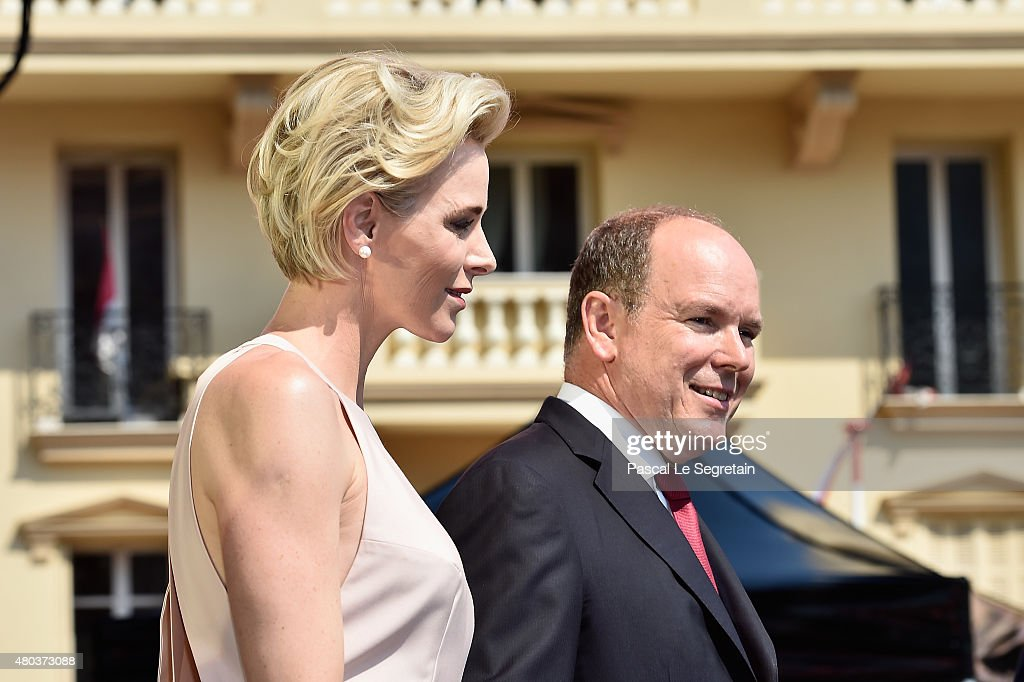 Princess Charlene of Monaco and Prince Albert II of Monaco pose onstage during the First Day of the 10th Anniversary on the Throne Celebrations on July 11, 2015 in Monaco, Monaco.