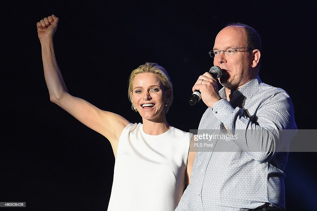Princess Charlene of Monaco and Prince Albert II of Monaco speak onstage during the Second Day of the 10th Anniversary on the Throne Celebrations on July 12, 2015 in Monaco, Monaco.