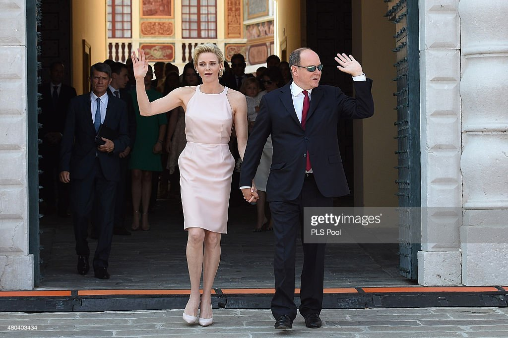 Princess Charlene of Monaco and Prince Albert II of Monaco walk on the Palace Place during the First Day of the 10th Anniversary on the Throne Celebrations on July 11, 2015 in Monaco, Monaco.
