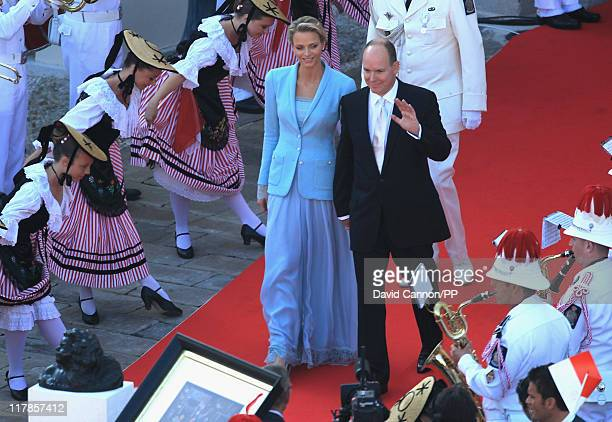Princess Charlene of Monaco and Prince Albert II of Monaco wave to well wishers after the civil ceremony of their Royal Wedding at the Prince's...