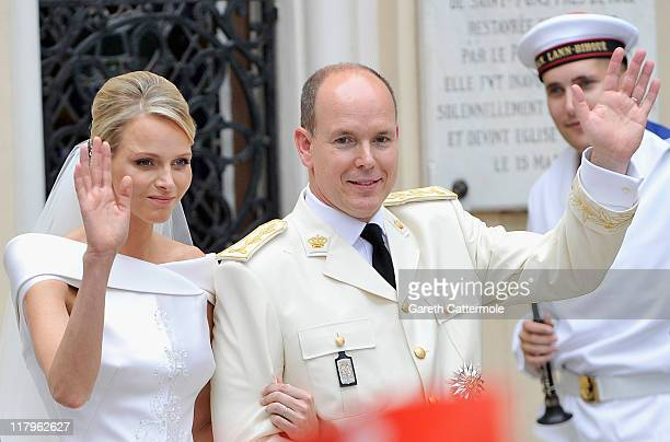 Princess Charlene of Monaco and Prince Albert II of Monaco wave to the crowd as they leave Sainte Devote church after their religious wedding...