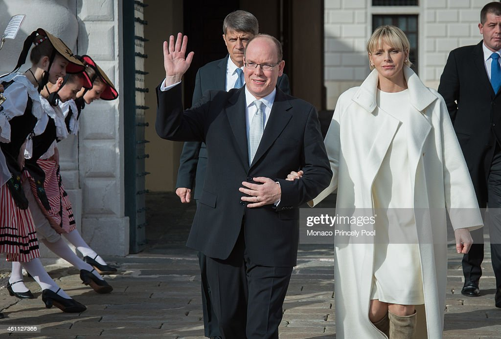 Princess Charlene of Monaco and Prince Albert II of Monaco wave to the crowd during the official presentation of the Monaco twins on January 7, 2015 in Monaco, Monaco.